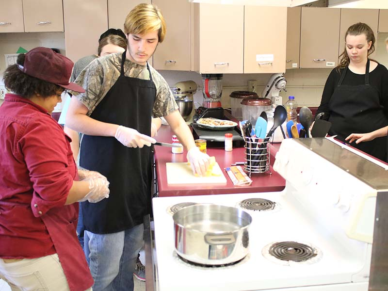 students learning how to cook