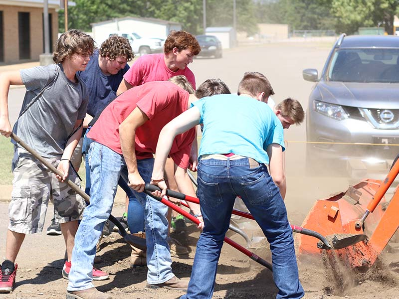 students digging gravel
